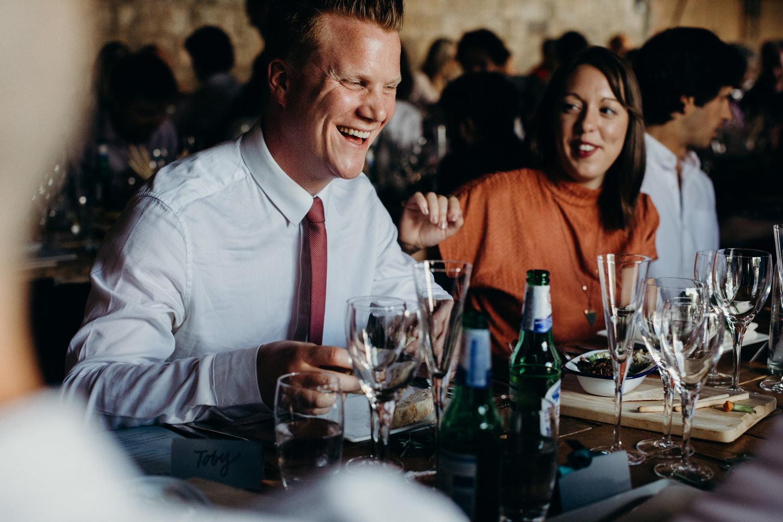 guests laughing at barn wedding