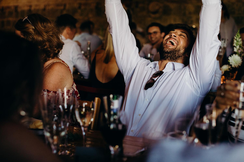 man laughs at wedding