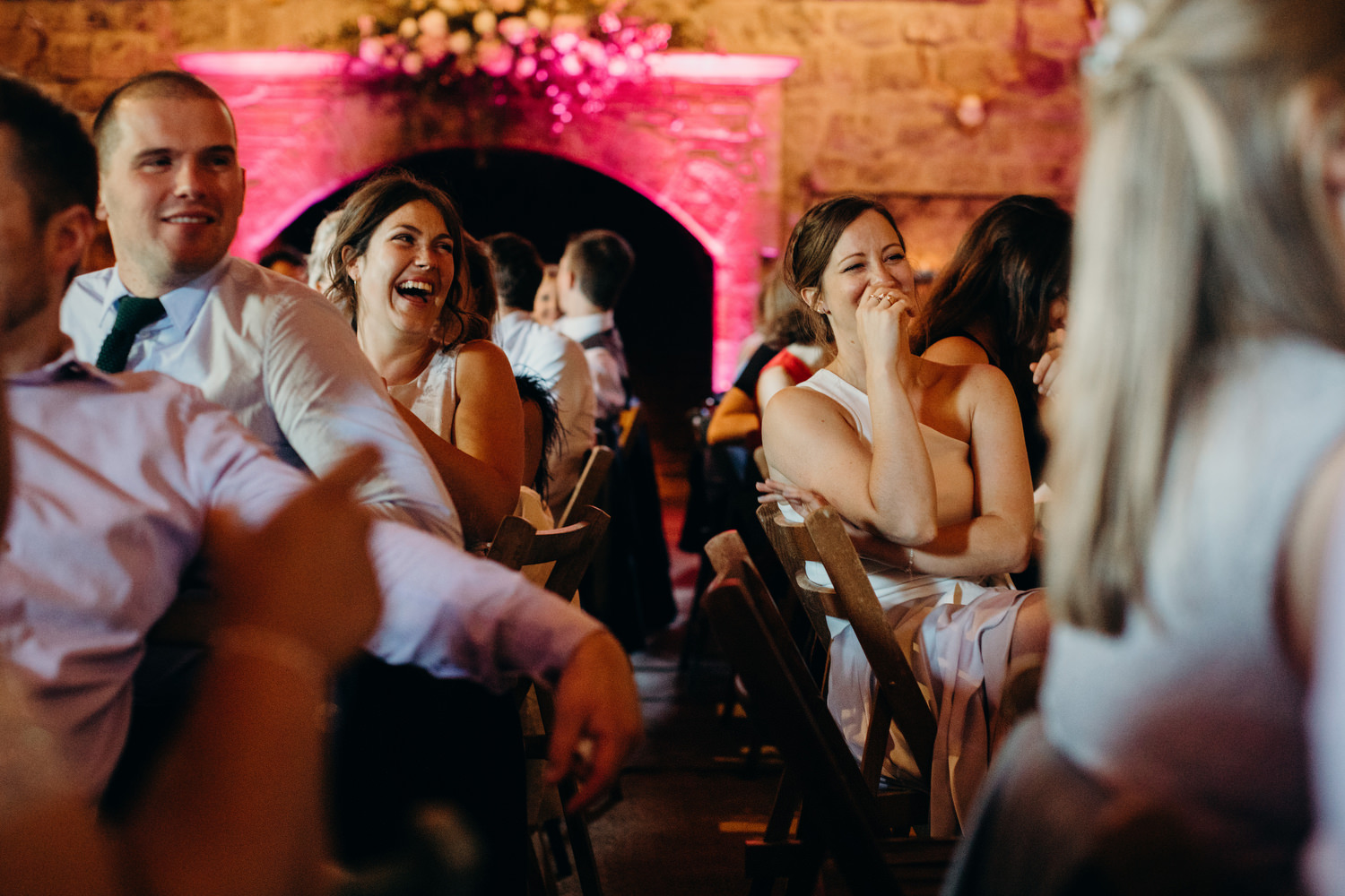 laughing guests at wedding