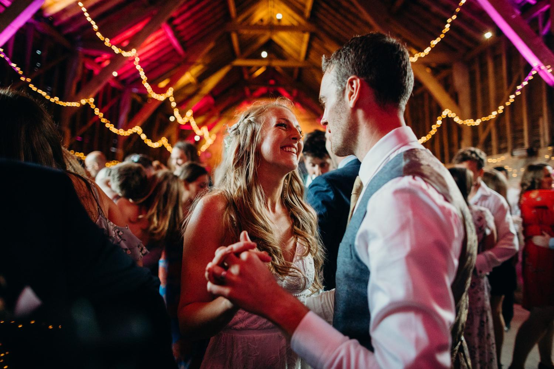 Bride looks lovingly at husband