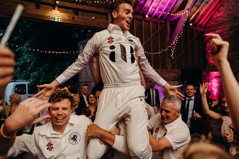 groom putting cricket gift on
