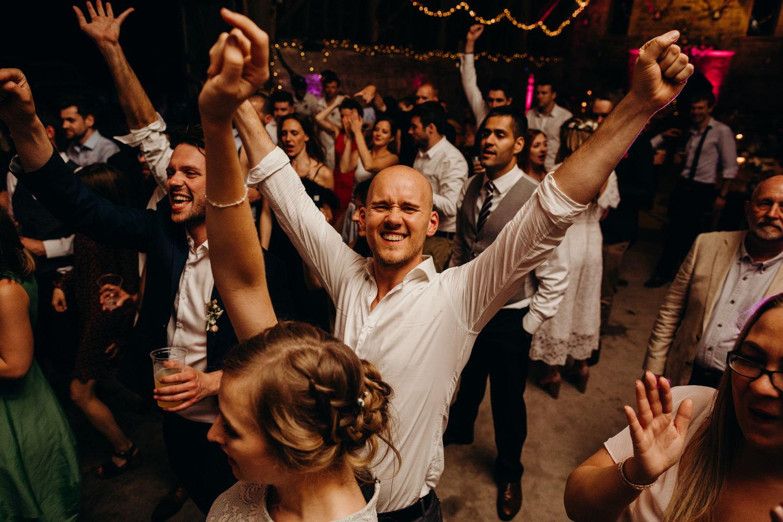 Guests puts hand up on dance floor