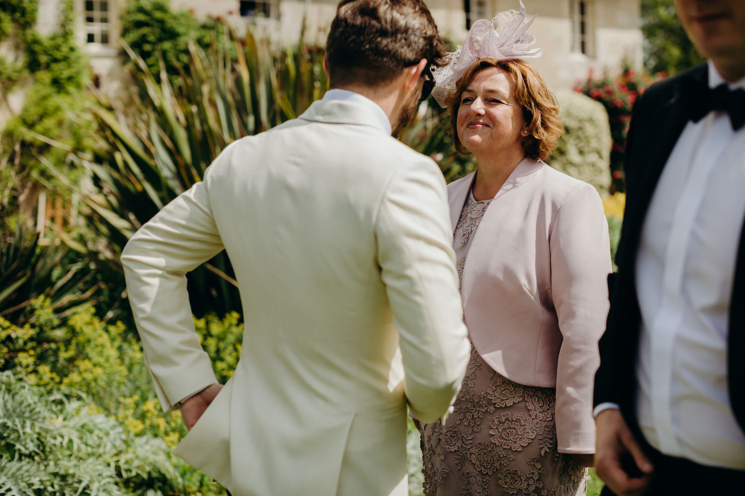 mother sees son in suit
