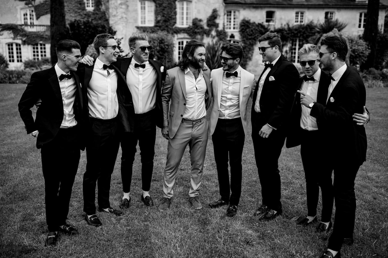 groom and ushers wearing black bow ties
