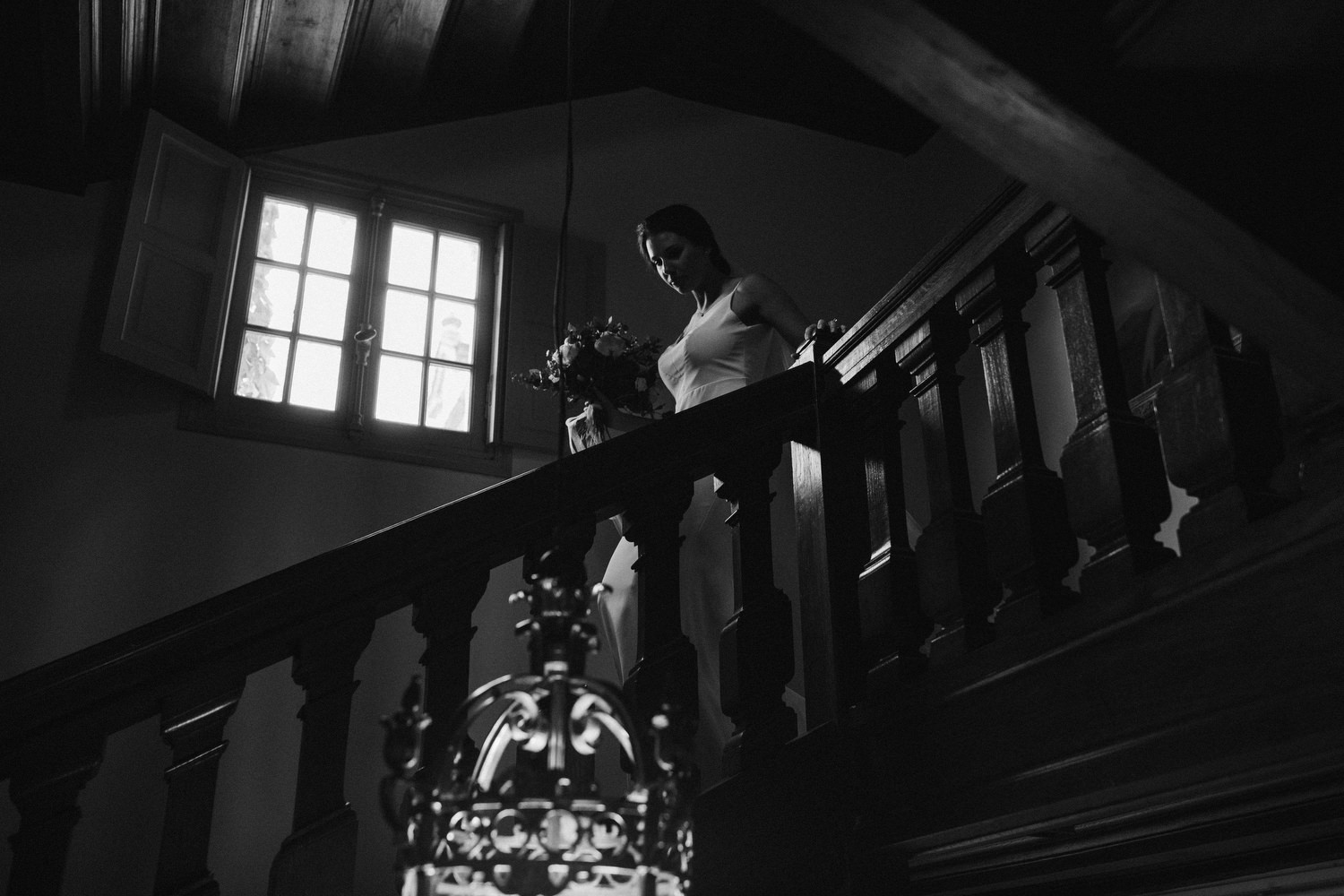 bride walks down stairs for ceremony