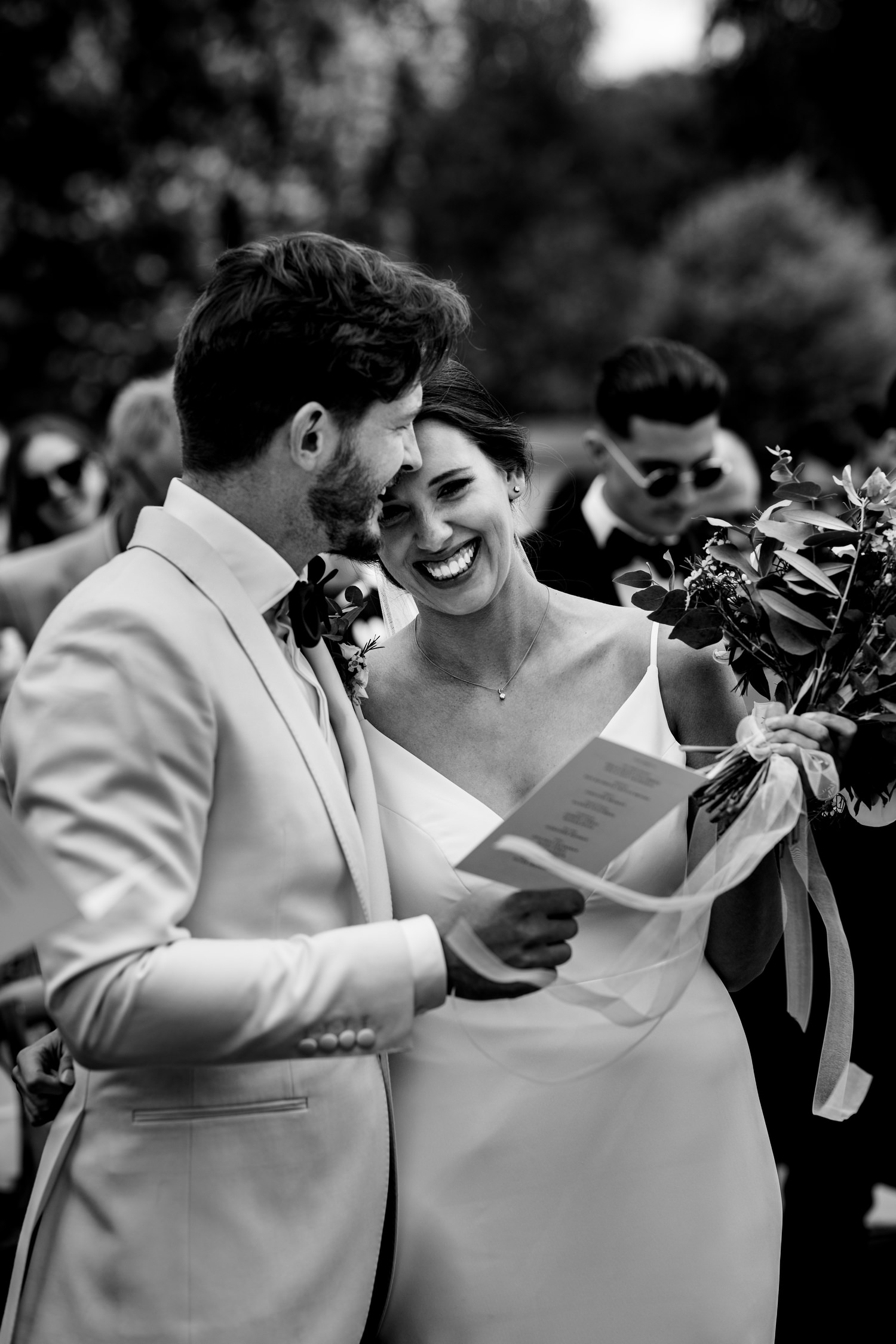 bride and groom share moment during ceremony