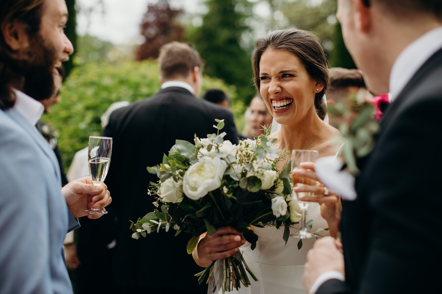 bride laughs at chateau drinks reception