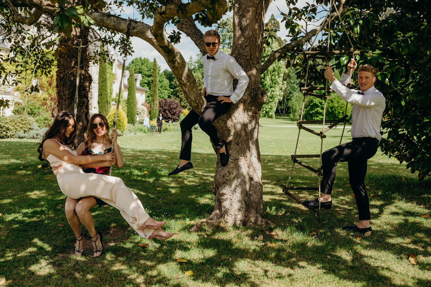 wedding guests pose for photograph