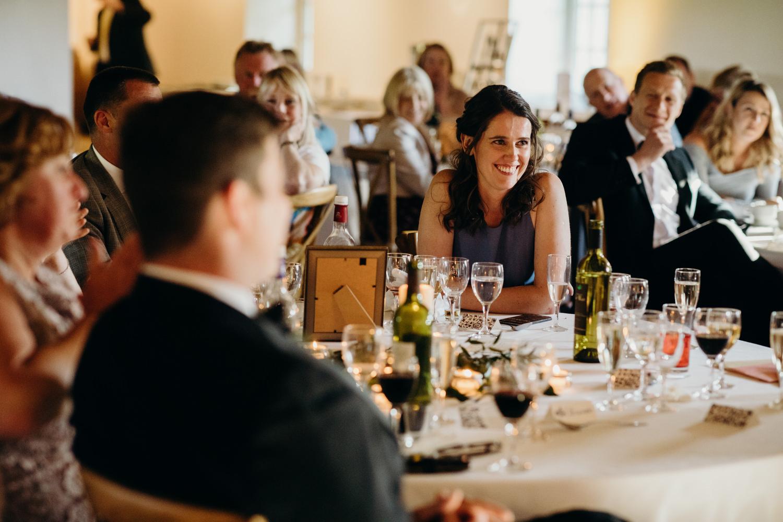 bridesmaid smiling during speeches