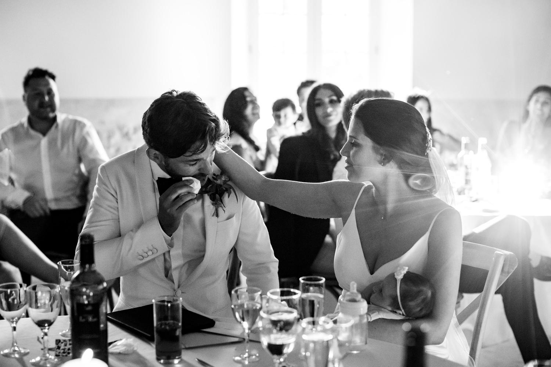 Bride comforts crying groom