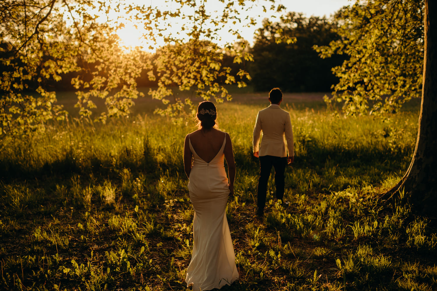 bride walks with groom for sunset pictures