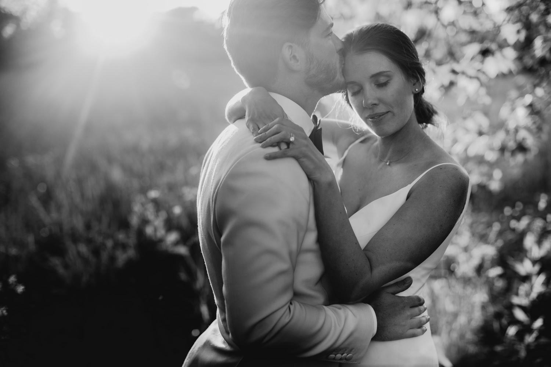 groom kisses bride on forehead