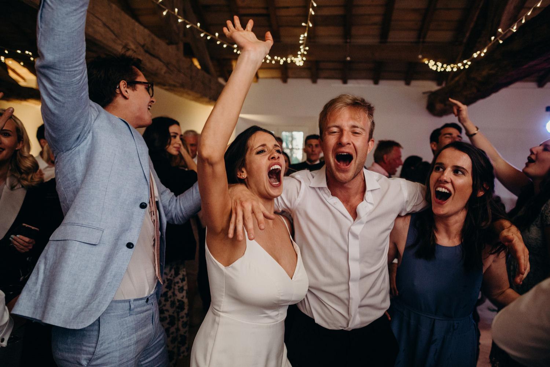 ecstatic guests dancing at wedding