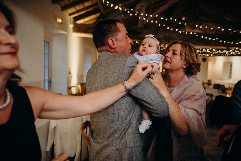baby at first wedding dancefloor