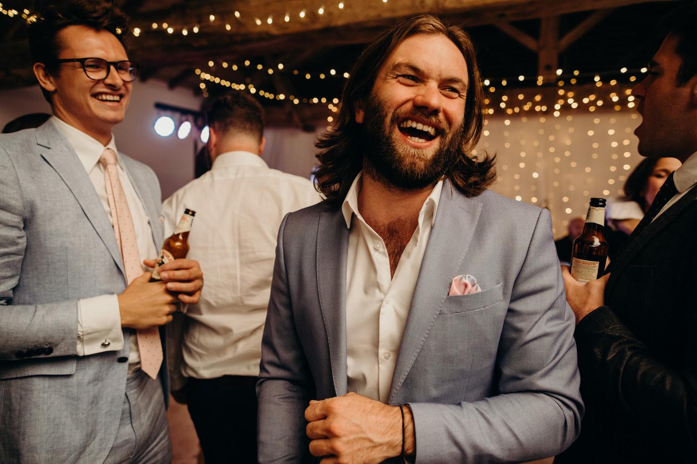 man smiles at chateau wedding
