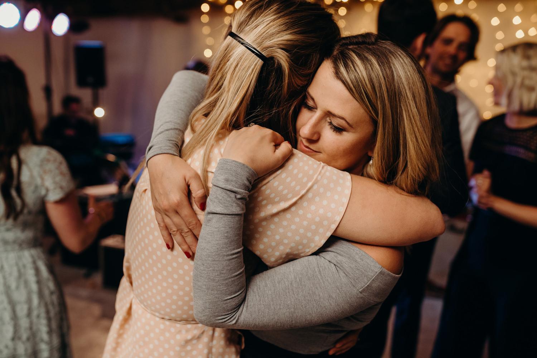 ladies hug at wedding