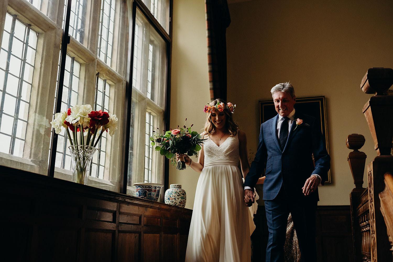 Bride and Father walk down principal staircase