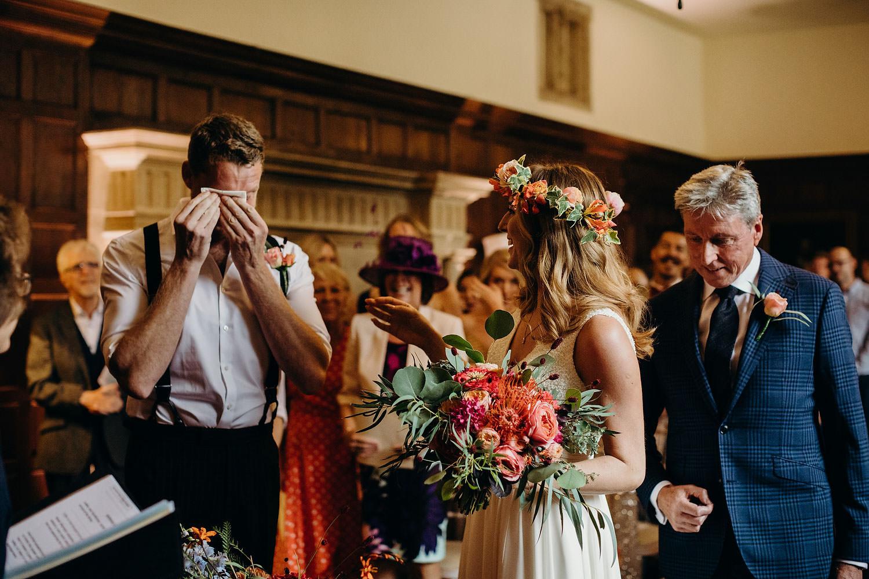 groom crying at wedding