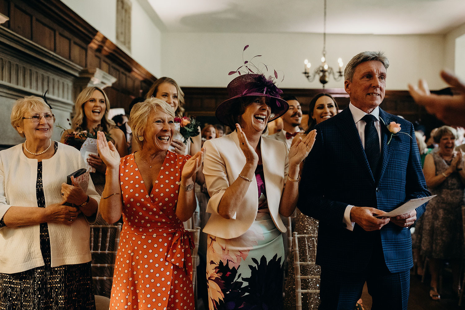 guests clap during ceremony