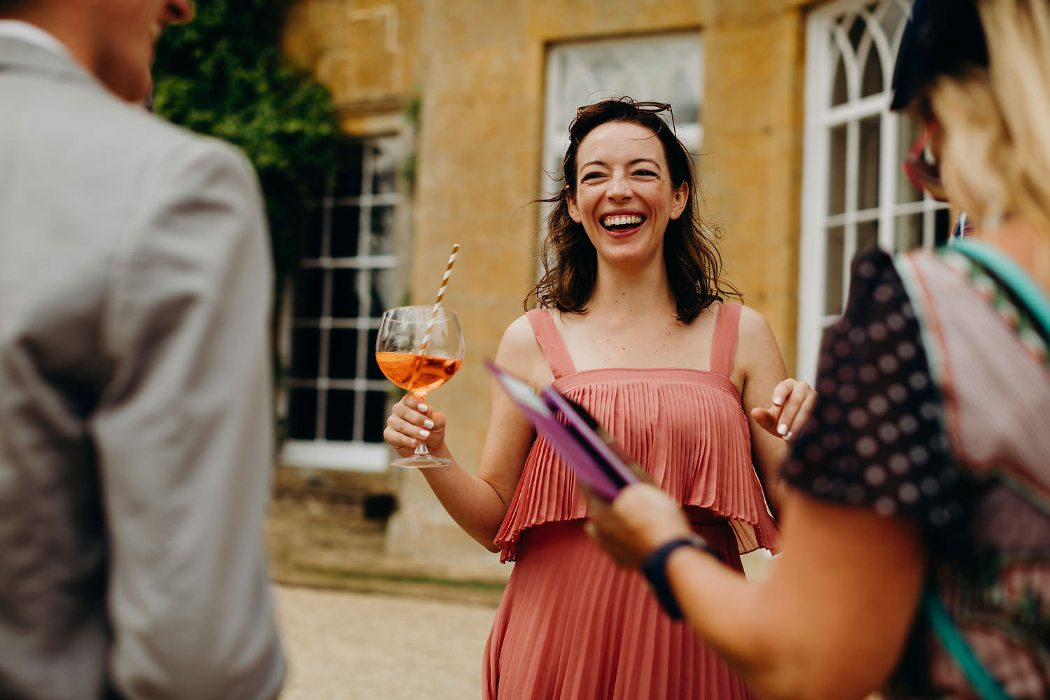 guests laughs at wedding drinks reception
