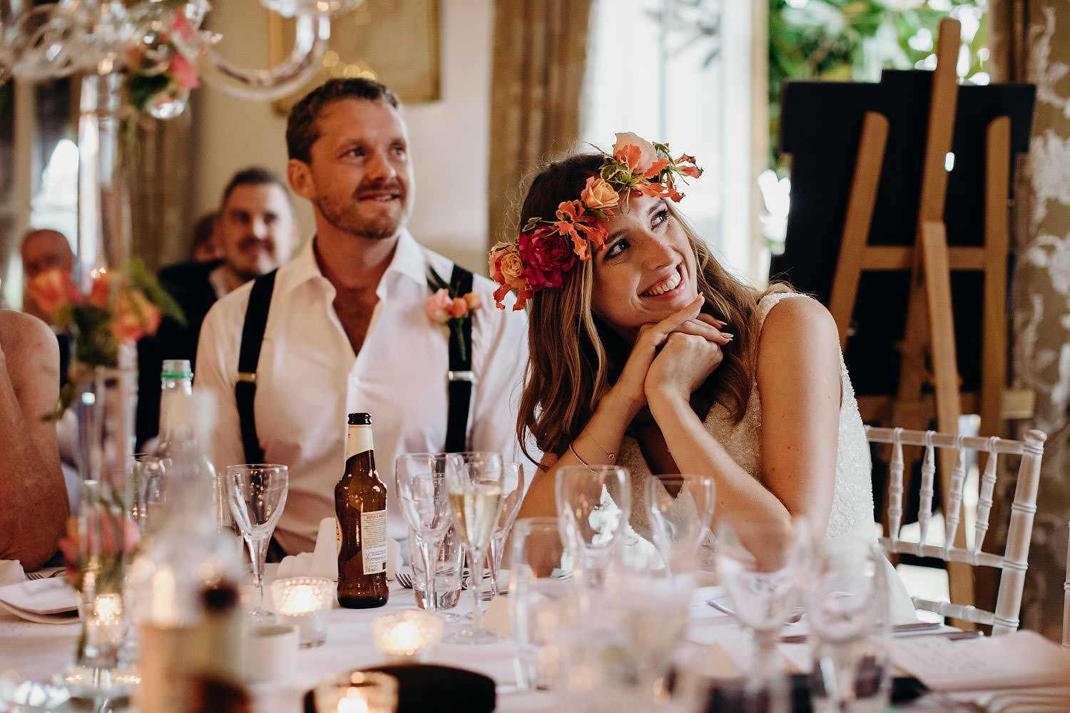 Bride smiling at father during speech