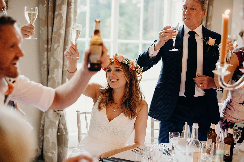 raising glasses at somerset wedding