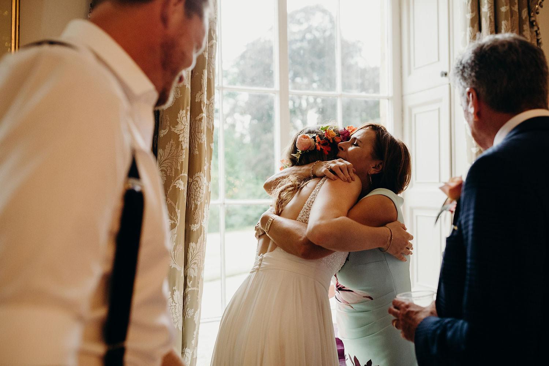 mum hugs bride