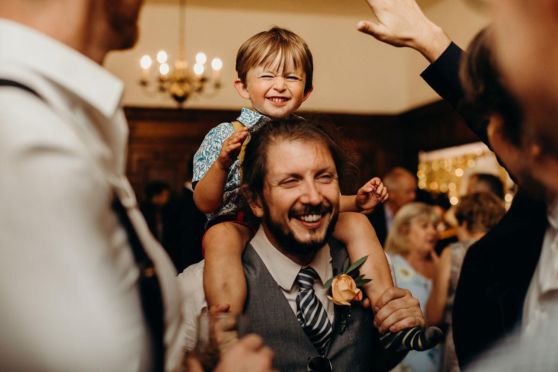 kid on shoulder smiling