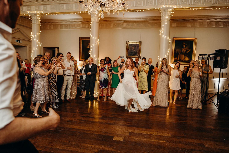 bride dances in background at wedding