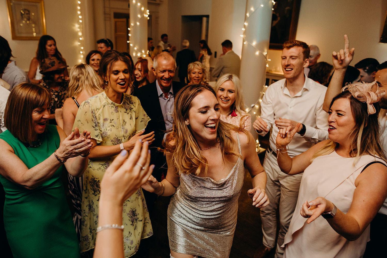 bride dances with guests cheering