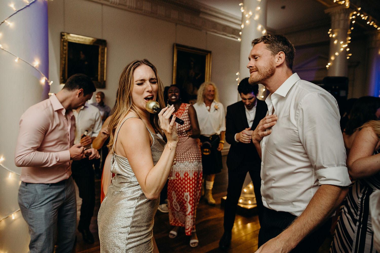 bride sings to groom on dance floor