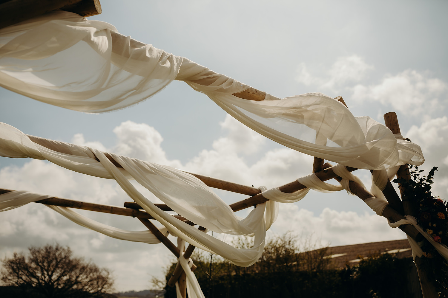ceremony space with sheets over wooden frame
