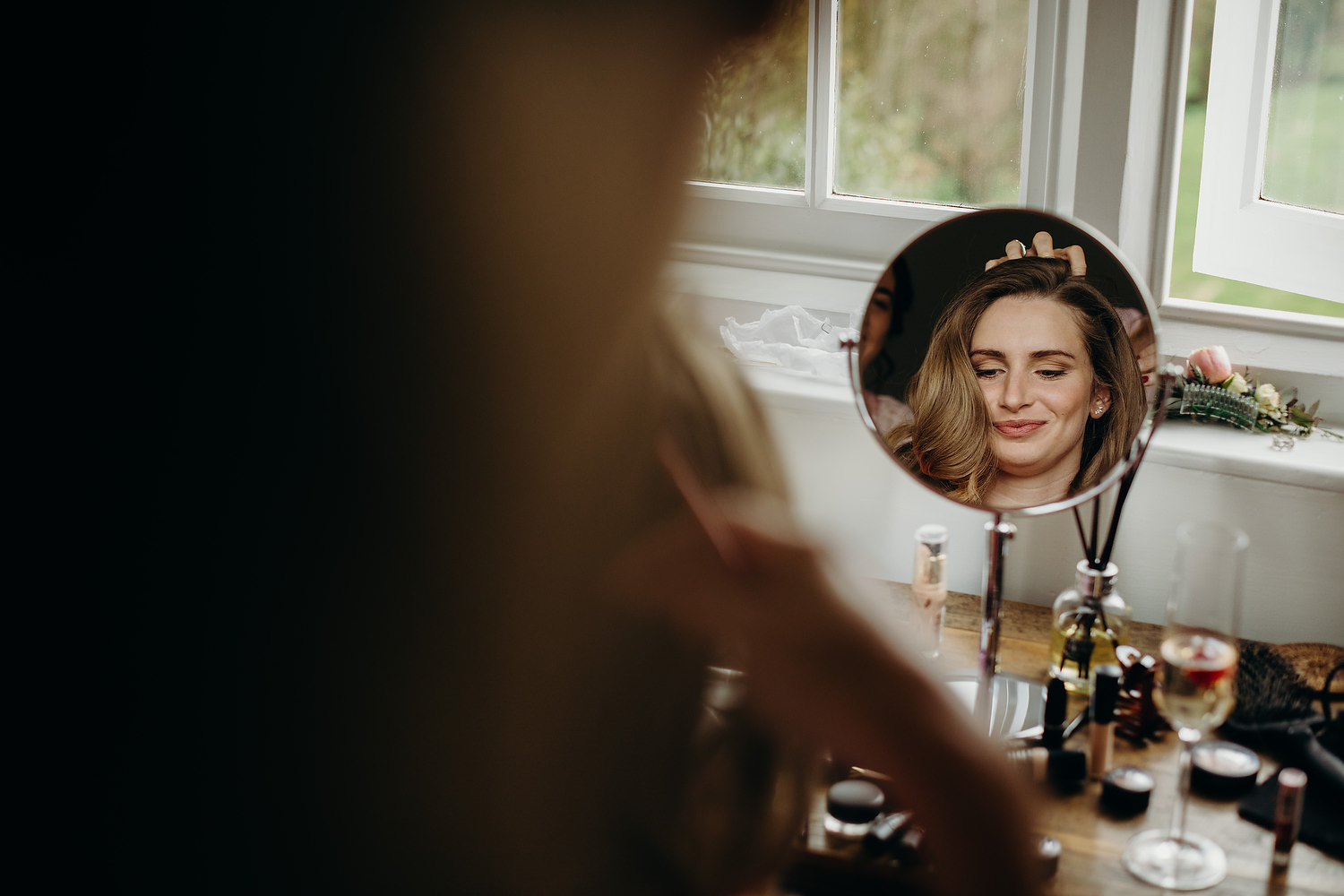 bride gets hair finished