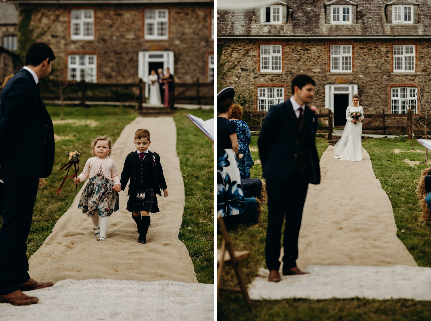 flower girl and page boy walk aisle