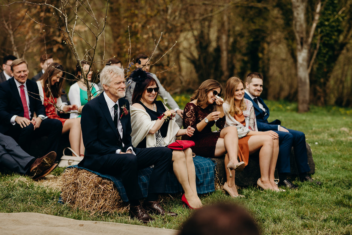 guests sit during outdoor wedding