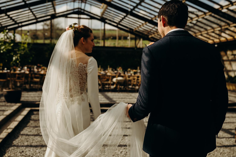 bride and groom at glasshouse at Anran
