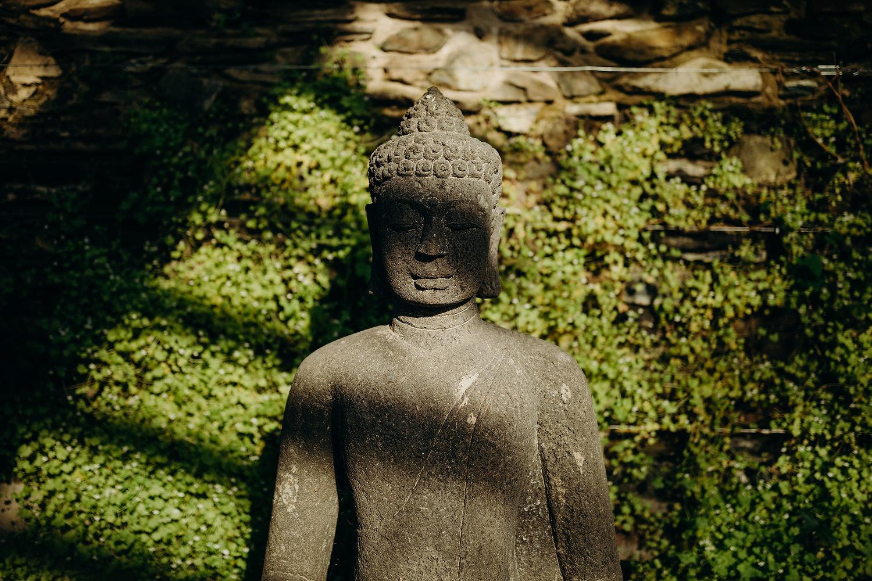 buddha in glasshouse