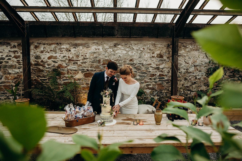 Couple cut wedding cake