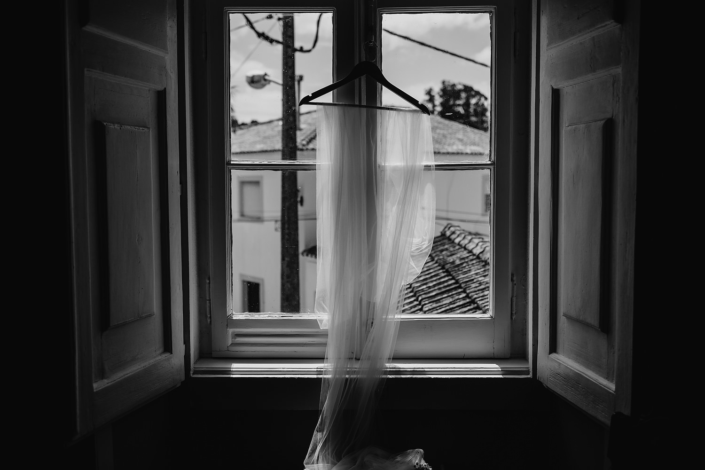 veil hangs in window
