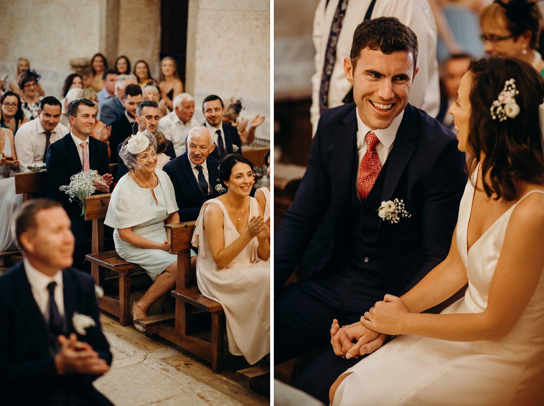 smiling during catholic wedding