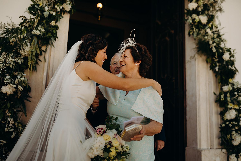 bride hugs mother