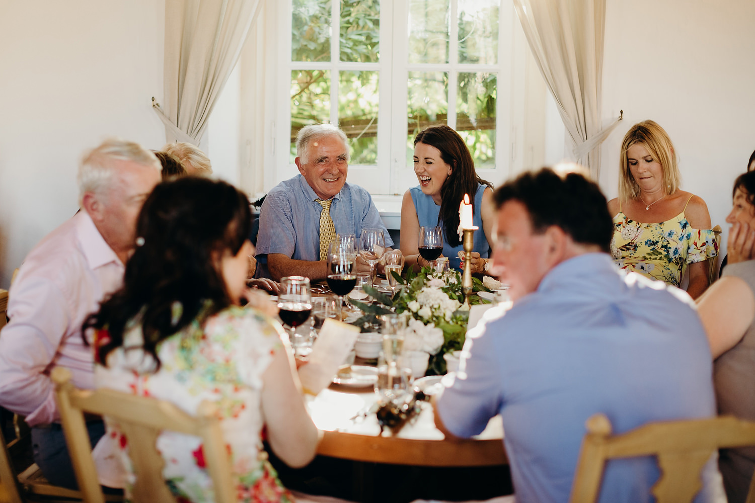 guests laughing on wedding table
