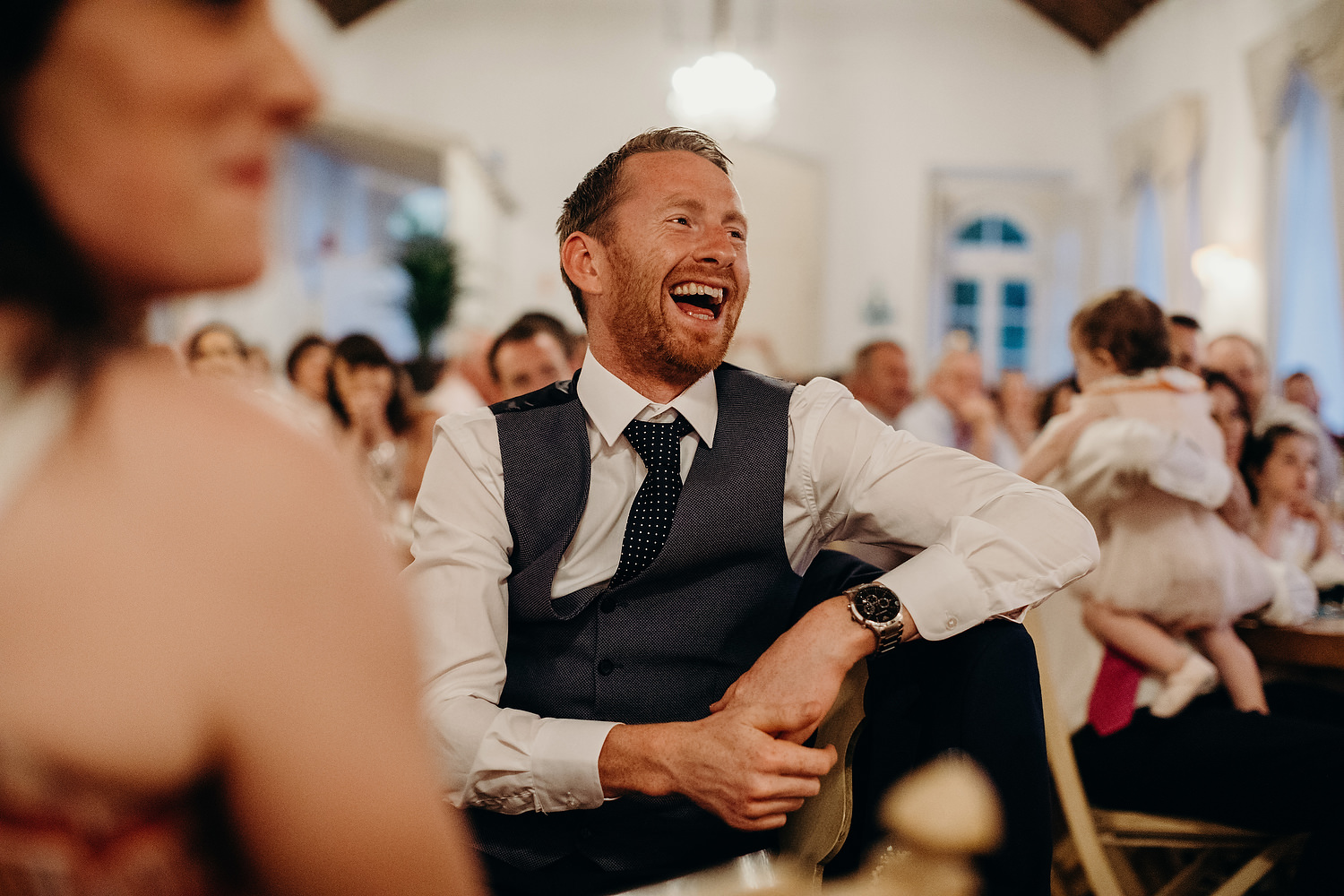 guests laughing during speeces