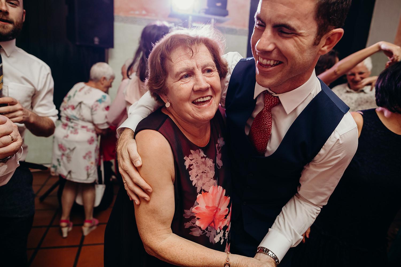 groom dancing with mother