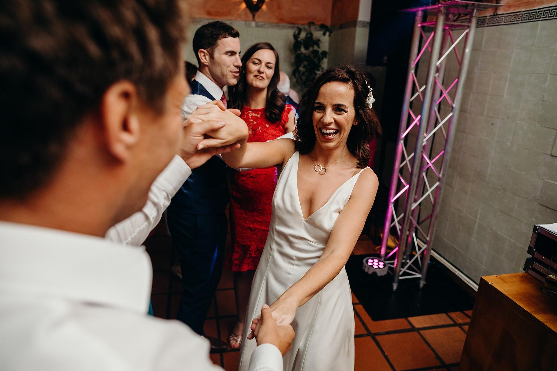 bride smiling on dancefloor