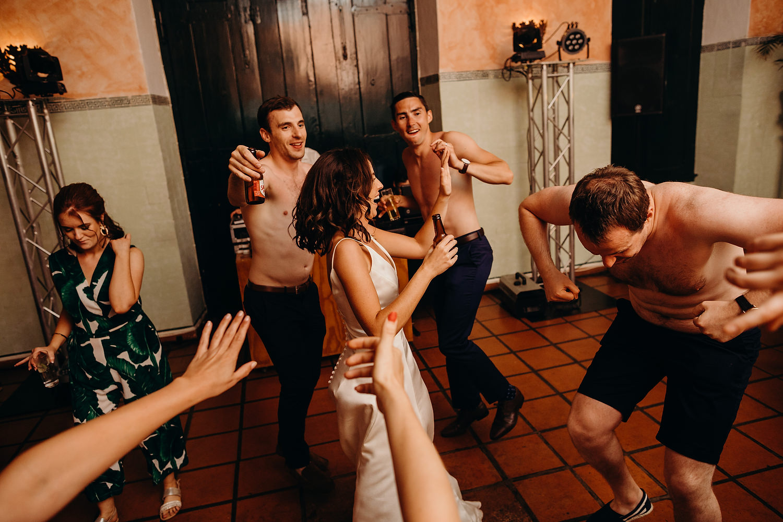 Naked men on dancefloor