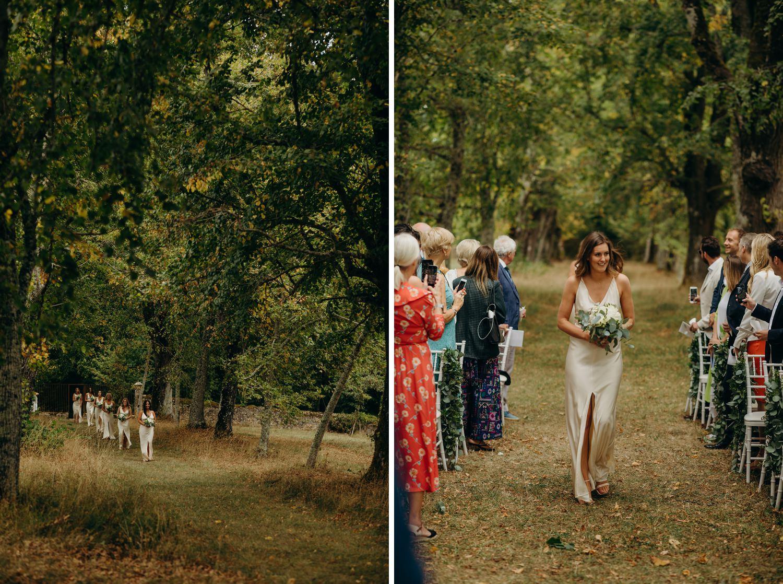 bridesmaids walking down tree lined aisle