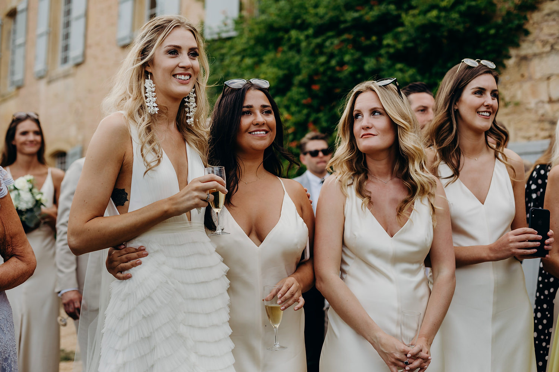 bride hugs friend during speeches