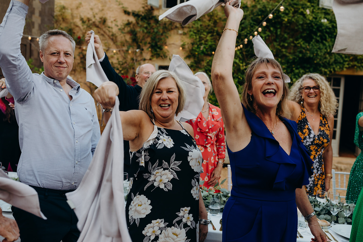 guests wave their napkins