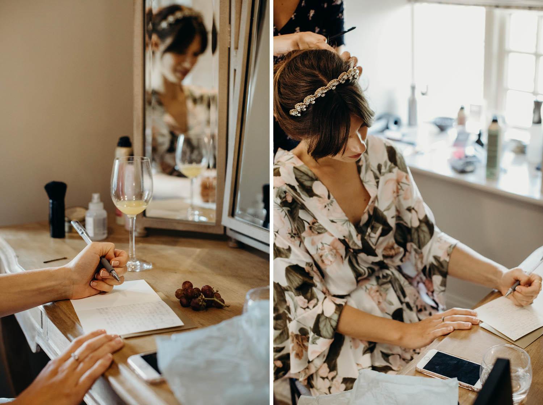 Bride writing card to groom